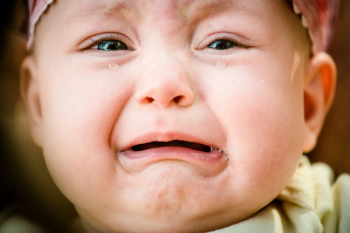 Baby crying - pure authentic emotion, tears visible